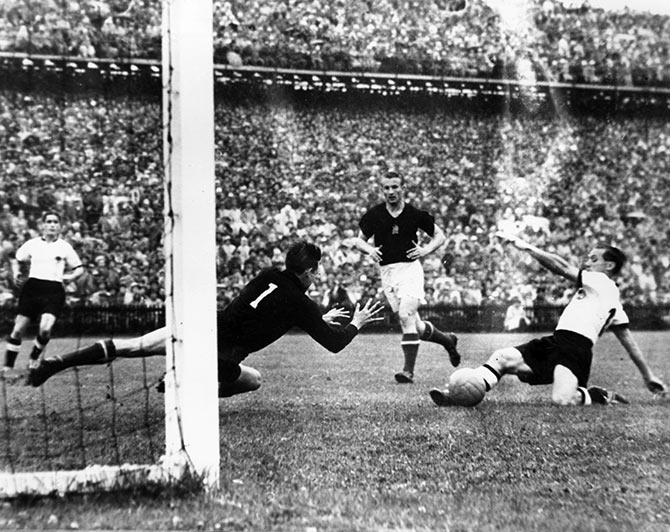 West Germany's Morlock scores against Hungary in the World Cup final in Berne, Switzerland.