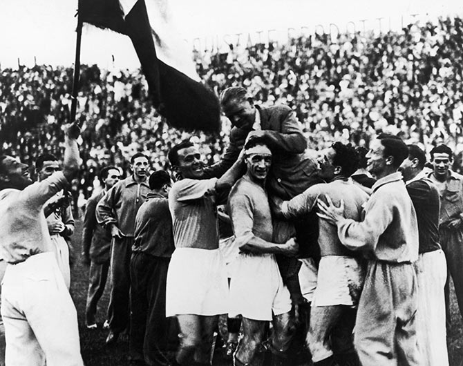 The Italian players carry their manager Vittorio Pozzo following their 2-1 victory over Czechoslovakia after extra time in the World Cup final in Rome on June 10, 1934.