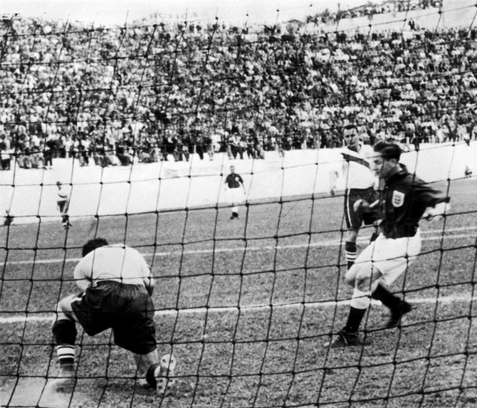 America's goalkeeper Frank Borghi saves a shot from Tom Finney of England during the World Cup match in Belo Horizonte, Brazil, on June 29, 1950.