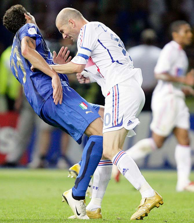 Italy's Marco Materazzi falls on the  pitch after being head-butted by France's Zinedine Zidane during the 2006 World Cup final in Berlin