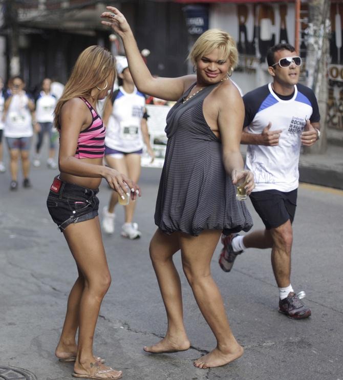 Residents dance at Rocinha slum in Rio de Janeiro