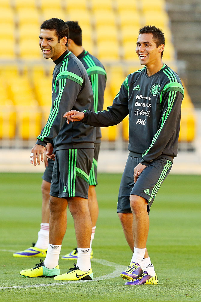 Rafael Marquez (left) and Paul Aguilar of Mexico enjoy a laugh during a team training session