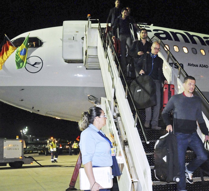 Members of Germany's national soccer team exit their plane upon arrival   in Salvador