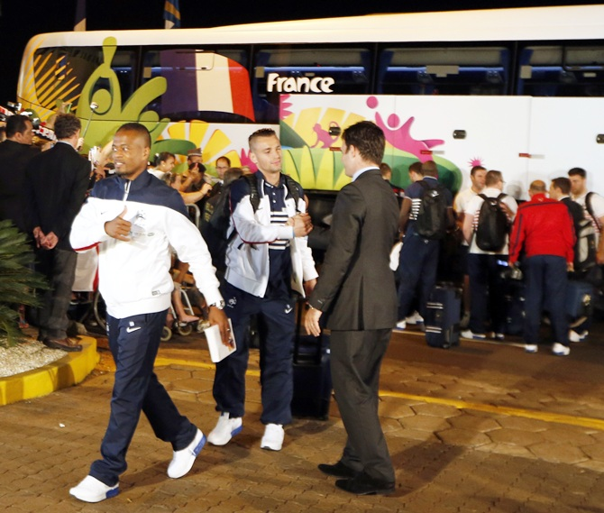 France's national soccer team players Patrice Evra,left, and Mathieu Debuchyarrive at their hotel, ahead of the 2014 World Cup, at Ribeirao Preto