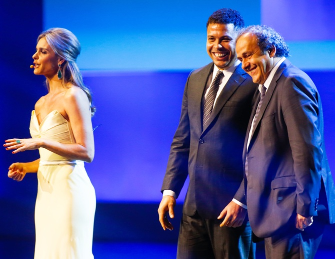 UEFA President Michel Platini,right, and Ronaldo Nazario stand onstage
