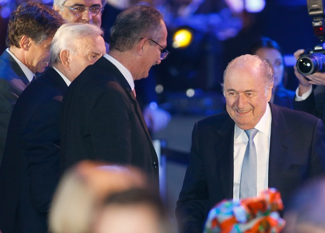 FIFA President Joseph Blatter,right, arrives at the opening ceremony of the 64th FIFA Congress