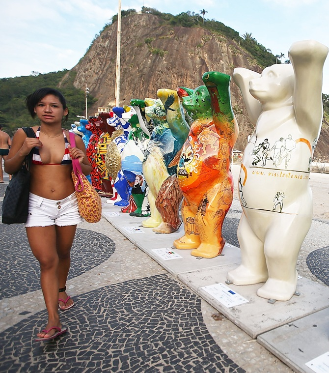 A bear statue stands amongst some of the 145 bear sculptures that form the 'United Buddy Bears' exhibition along famed Copacabana beach in Rio de Janeiro. The project promotes tolerance in the world