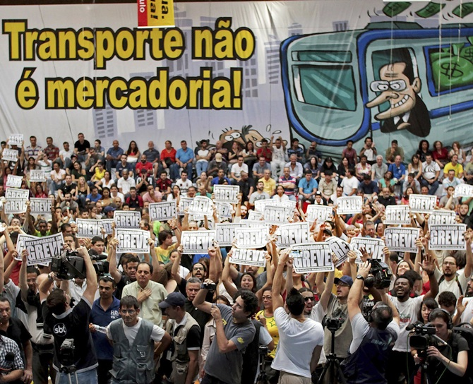 An assembly of Sao Paulo's metro workers debate whether to continue their strike