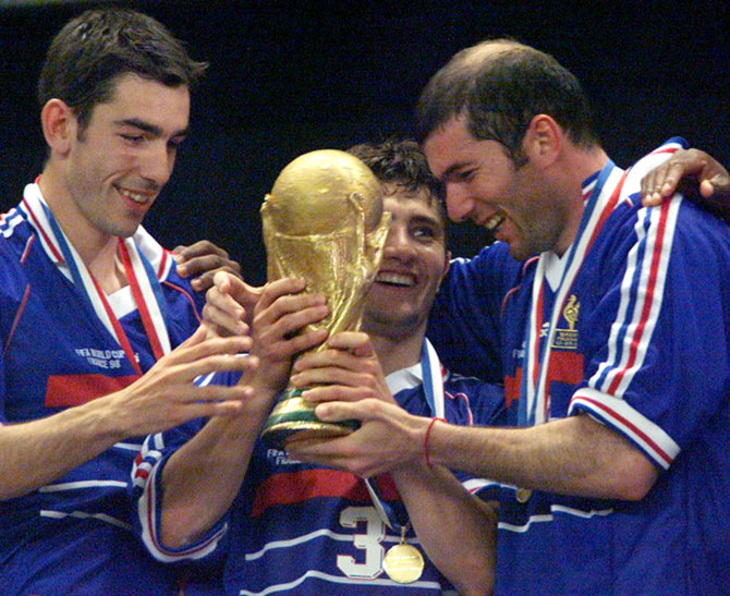 Zinedine Zidane (right) celebrates with his France team mates after winning the 1998 World Cup final in Paris, on July 12, 1998.