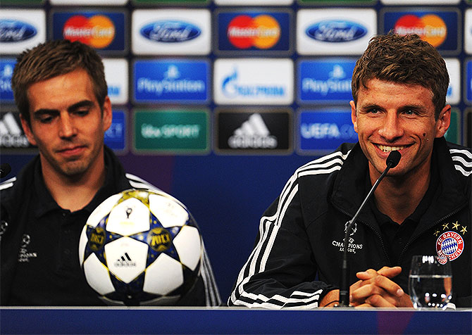Philipp Lahm (left) and Thomas Mueller during a FC Bayern Muenchen press conference