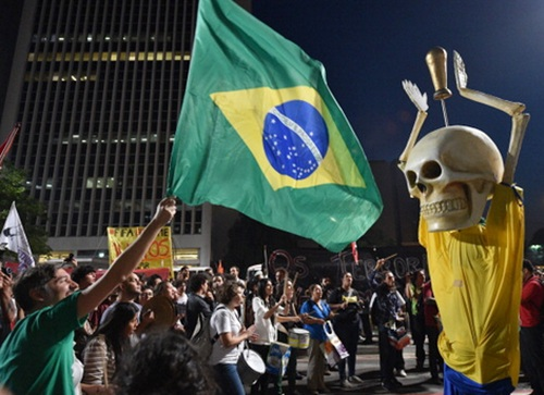 People take part in the 'International Day of World Cup Resistance'   protest against the upcoming FIFA World Cup Brazil 2014 along the streets of Sao Paulo