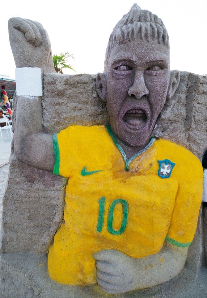 A sandcastle model of Neymar on the Copacabana Beach in Rio de Janeiro.