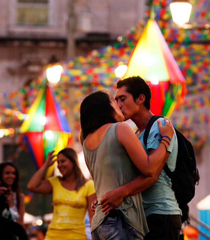 ouple kiss at a public square where the fan zone for soccer matches will be held at Pelourinho neigborhood ahead of the 2014 World Cup in Salvador