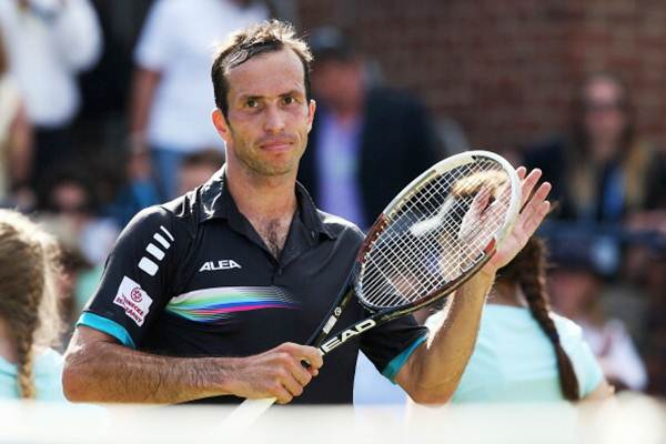 Radek Stepanek of the Czech Republic reacts after defeating Andy Murray of Great Britain during their men's singles match of the Aegon Championships at Queens Club