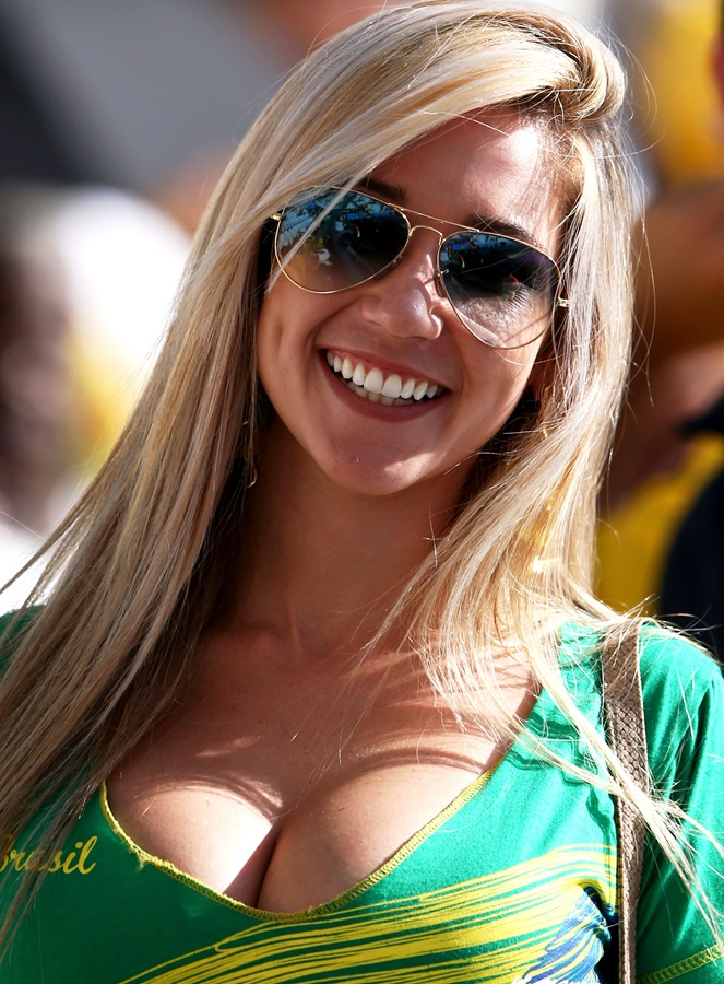A Brazil fan smiles before the Opening Ceremony of the 2014 FIFA World Cup