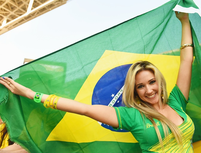 A fan waves a Brazilian flag