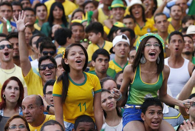 Brazilian fans celebrate at Copacabana beach in Rio