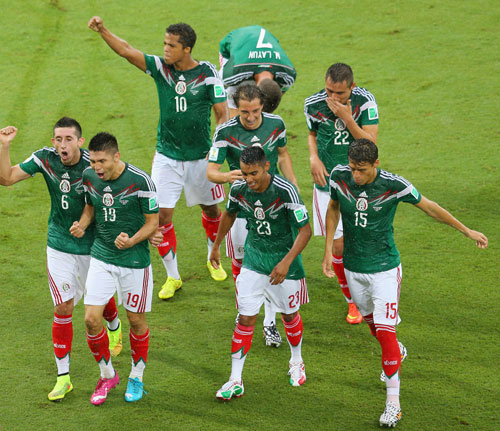 Oribe Peralta of Mexico (19) runs to the sidelines to celebrate his goal with teammates