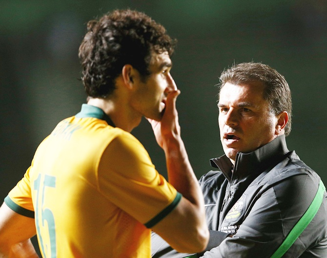 Socceroos coach Ange Postecoglou talks to Socceroos captain Mile Jedinak