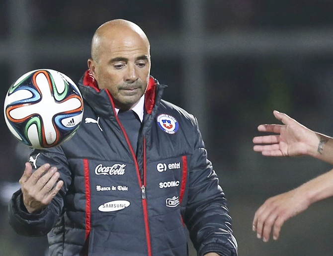 Chile's coach Jorge Sampaoli bounces a ball mid-air