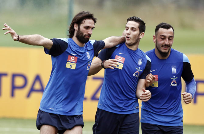 Greece's Kostas Mitroglou (right), Kostas Manolas (centre) and Georgios Samaras attend a training session
