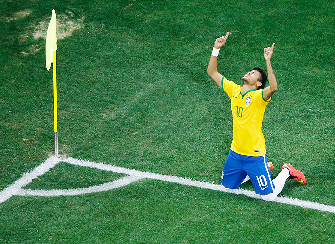 Neymar of Brazil celebrates scoring his second goal against Croatia at Arena de Sao Paulo in Sao Paulo on Thursday