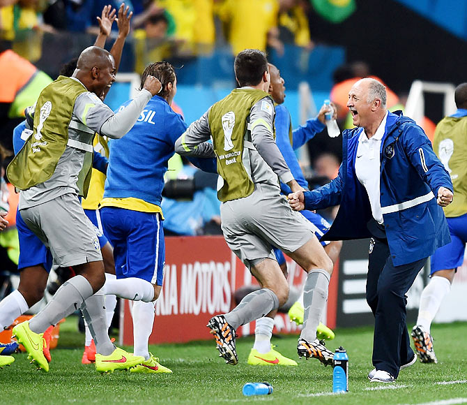 Head coach Luiz Felipe Scolari of Brazil (right) celebrates with his team after their win over Croatia on Thursday