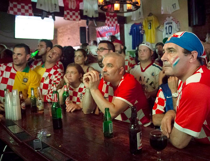 Croatian fans watch the opening match of the football World Cup in a bar on Thursday
