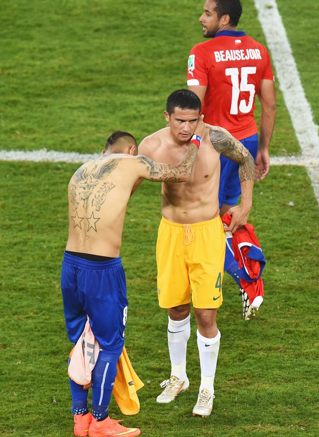 Arturo Vidal of Chile, left, and Tim Cahill of Australia swap jerseys