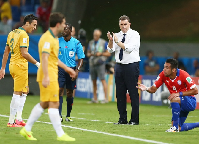 Head coach Ange Postecoglou of Australia claps from the sideline