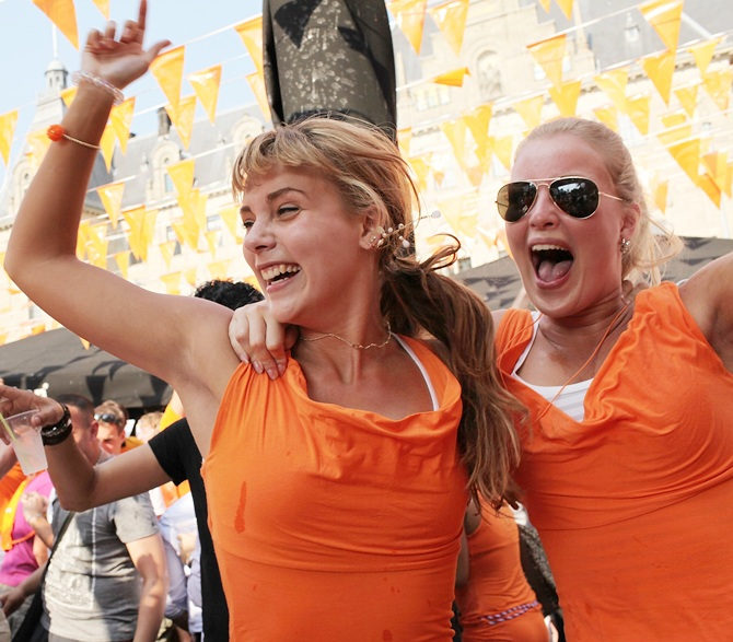 Dutch fans celebrate at an open air bar