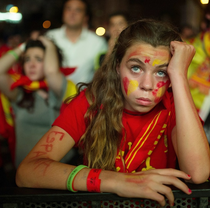 A Spanish soccer fans watches