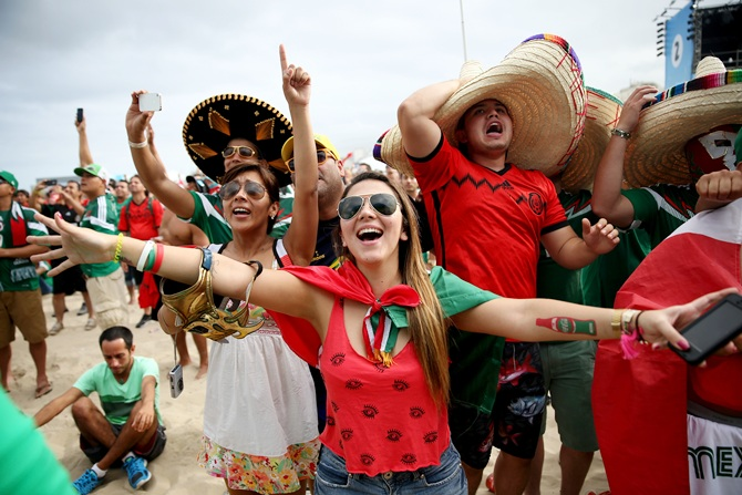 Mexican soccer team fans react to their team winning the match against Cameroon