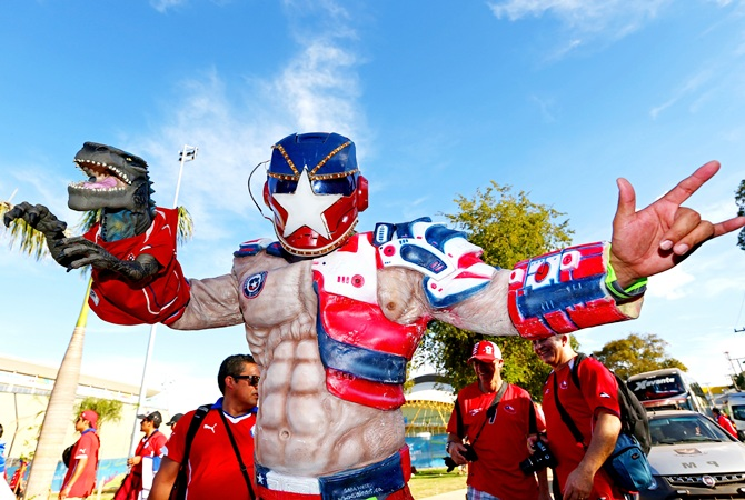 A Chile fan enjoys the atmosphre prior to the 2014 FIFA World Cup match