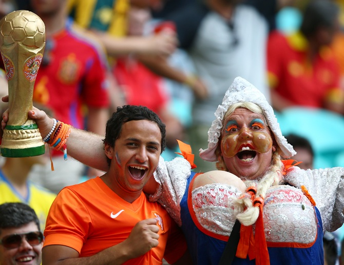 Fans watch the football game featuring Spain vs Netherland on the giant screen