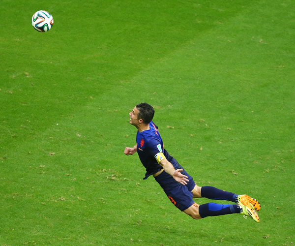 Robin van Persie of the Netherlands scores the team's first goal with a diving header