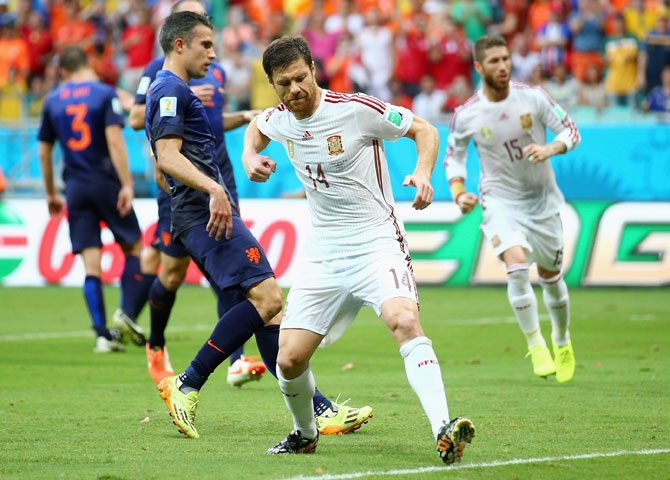 Xabi Alonso of Spain celebrates after scoring from a penalty kick