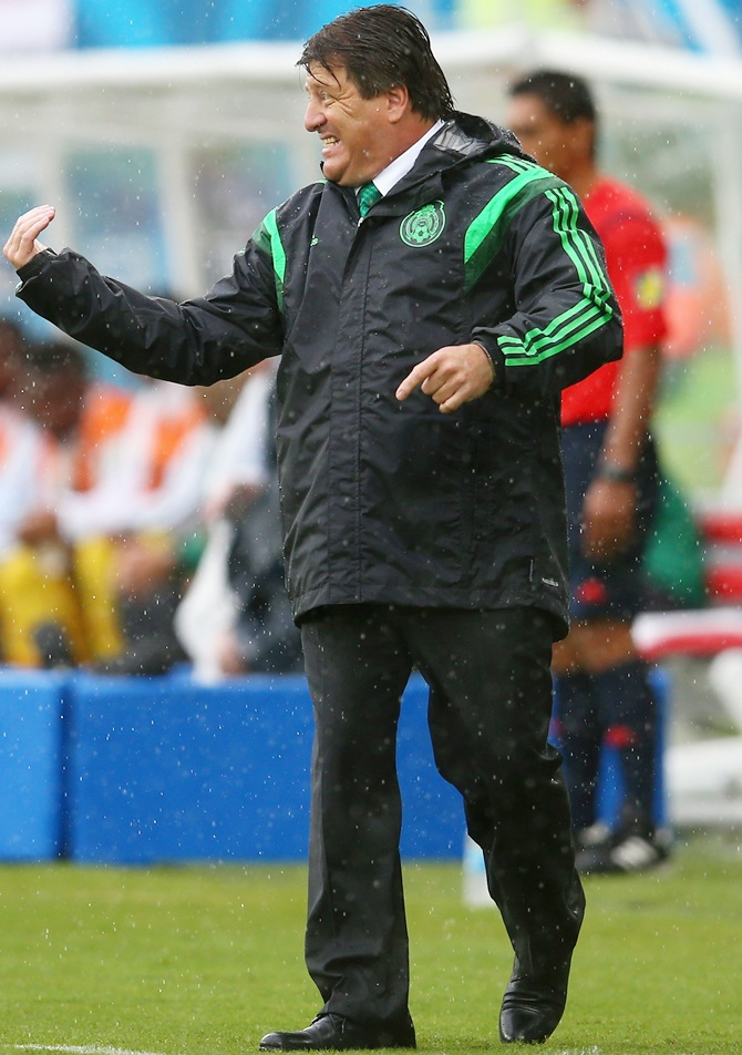 Head coach Miguel Herrera of Mexico reacts