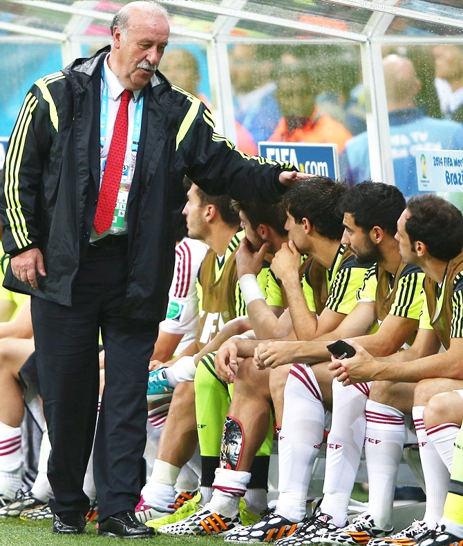 Head coach Vicente del Bosque of Spain speaks to his players on the bench