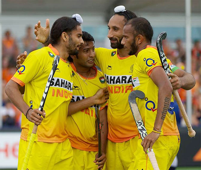 India players celebrate a goal