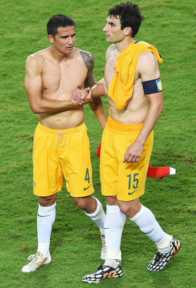 Tim Cahill (left) and Mile Jedinak of Australia shake hands after being defeated by Chile 3-1 on Friday