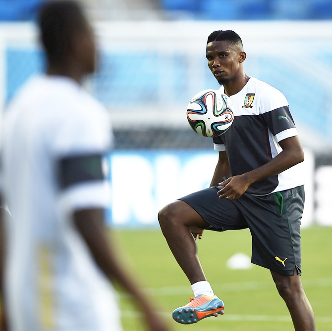 Cameroon's captain Samuel Eto'o, right, controls the ball during a team practice session