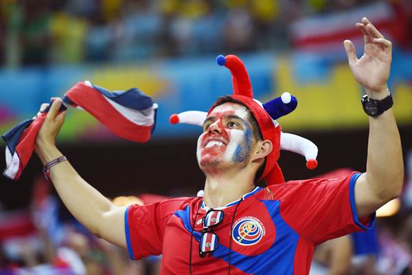 A Costa Rica fan celebrates the unexpected victory