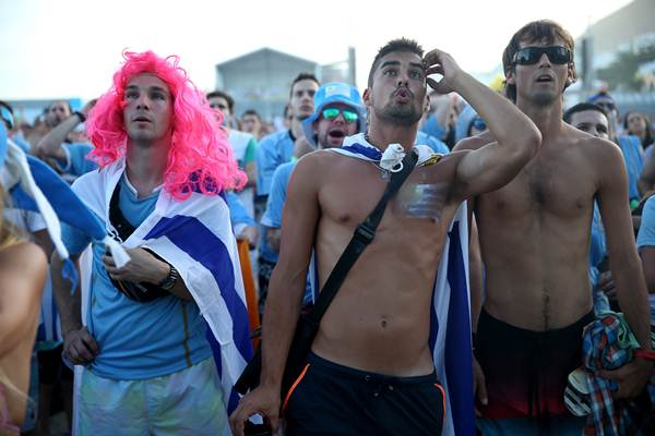 Uruguay fans react after their team concedes the third goal against Costa Rica