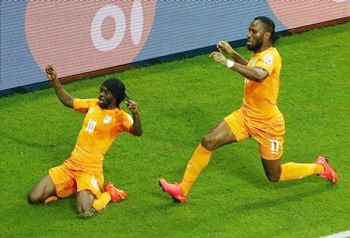 Ivory Coast's Gervinho (left) and Didier Drogba celebrate their goal against Japan