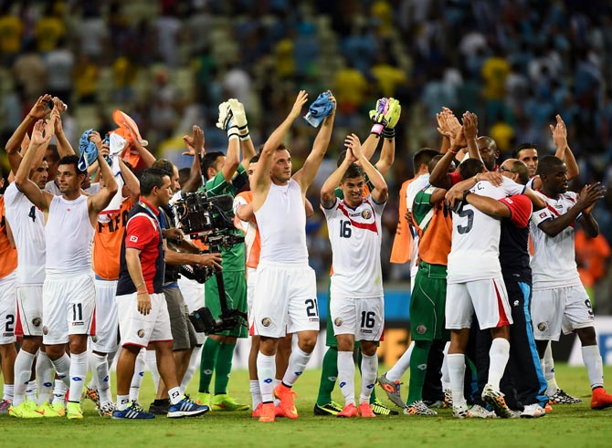 Costa Rica's players celebrate after their victory against Uruguay
