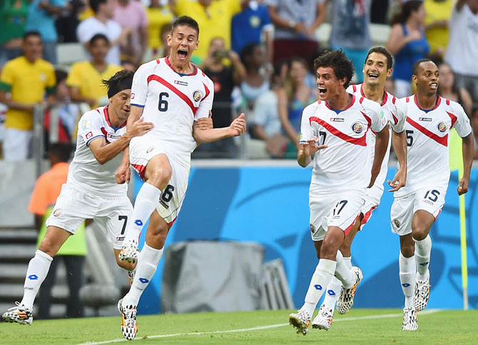 Oscar Duarte of Costa Rica (second left) celebrates scoring his team's second goal against Uruguay with teammates