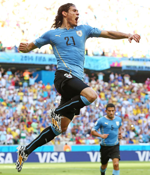 Edinson Cavani of Uruguay celebrates scoring his team's first goal on a penalty kick