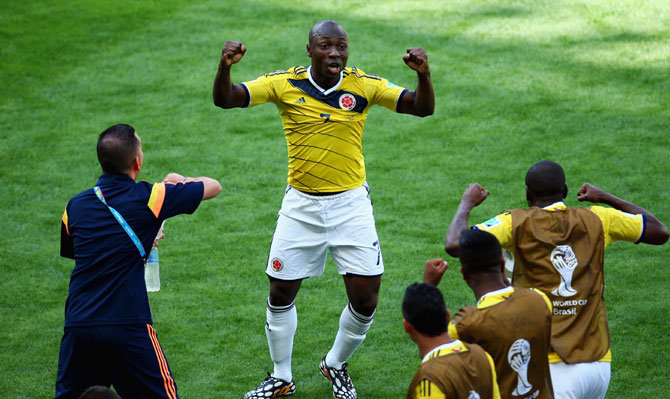 Pablo Armero of Colombia celebrates with his team-mates after scoring the first goal