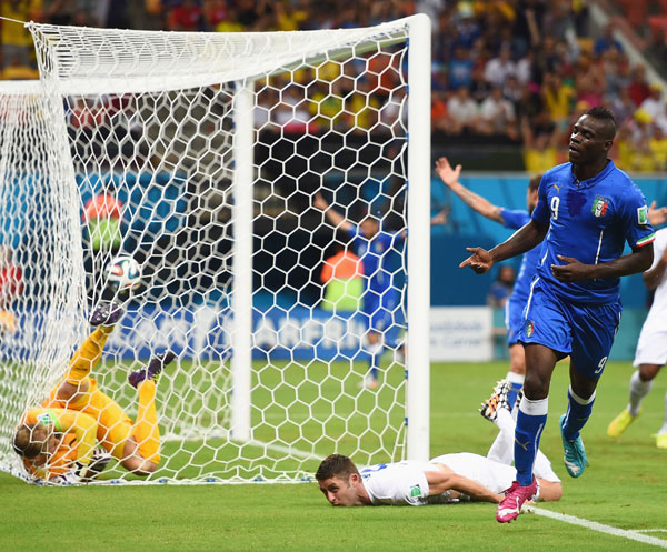 Mario Balotelli of Italy celebrates after scoring his team's second goal against England